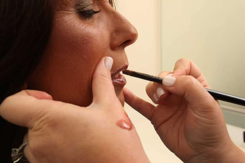 Linda Beyer has her makeup done for her