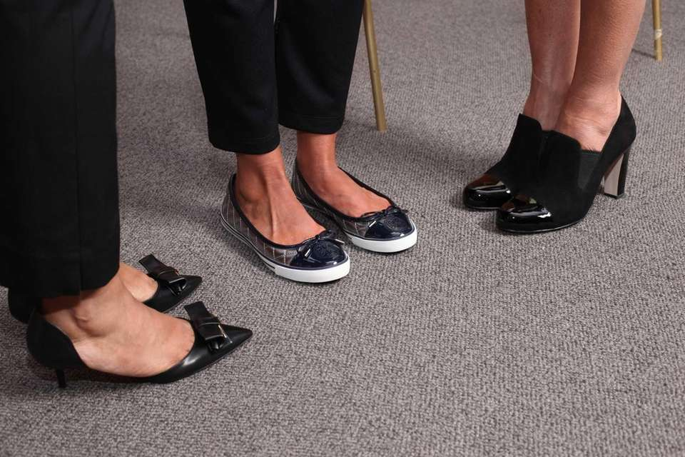 The teachers show off their new shoes. (Aug.
