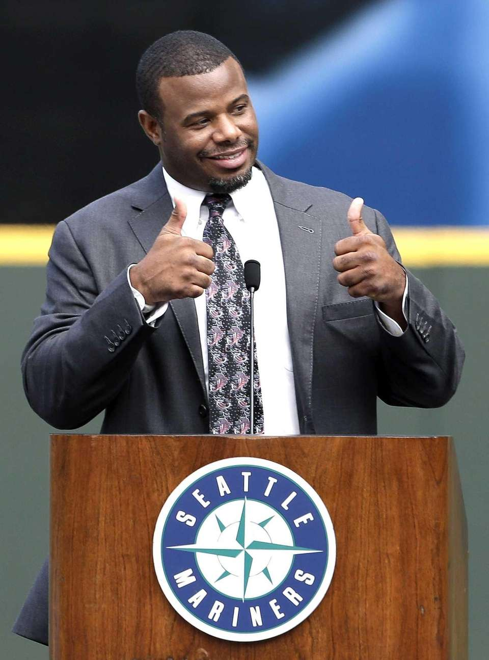 Former Seattle Mariners' Ken Griffey Jr. imitates the