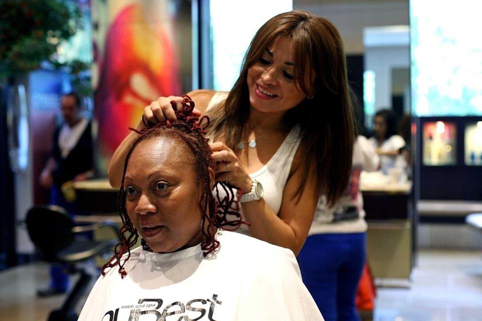 Teacher Carol Copper has a consultation with stylist