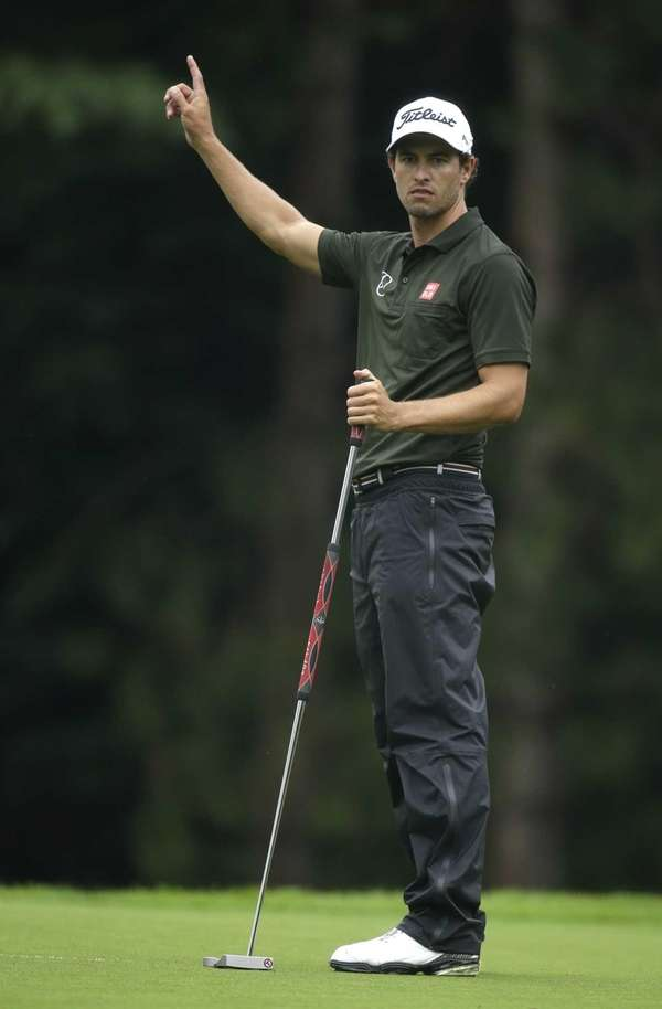 Adam Scott, of Australia, celebrates after a birdie