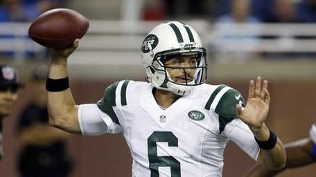 Jets quarterback Mark Sanchez throws during the first