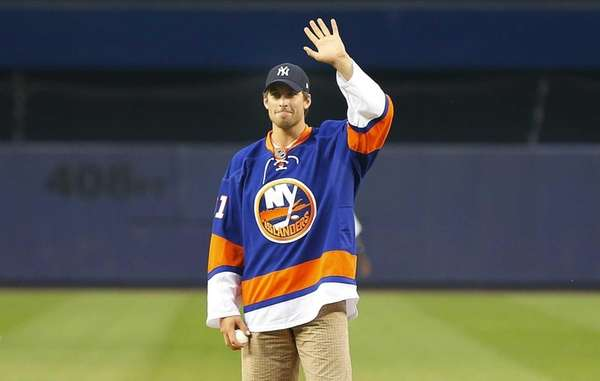 John Tavares of the Islanders waves before throwing