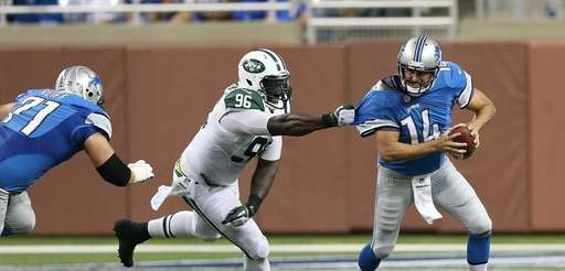Muhammad Wilkerson of the Jets grabs the jersey