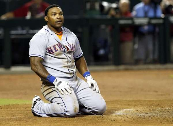 Mets' Marlon Byrd kneels at the plate after