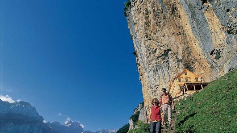 The Alpine restaurant Aescher-Wildkirchli in the rock face