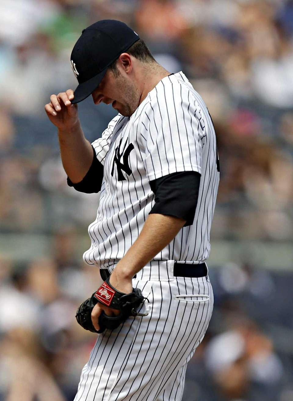 Yankees starting pitcher Phil Hughes takes a breather