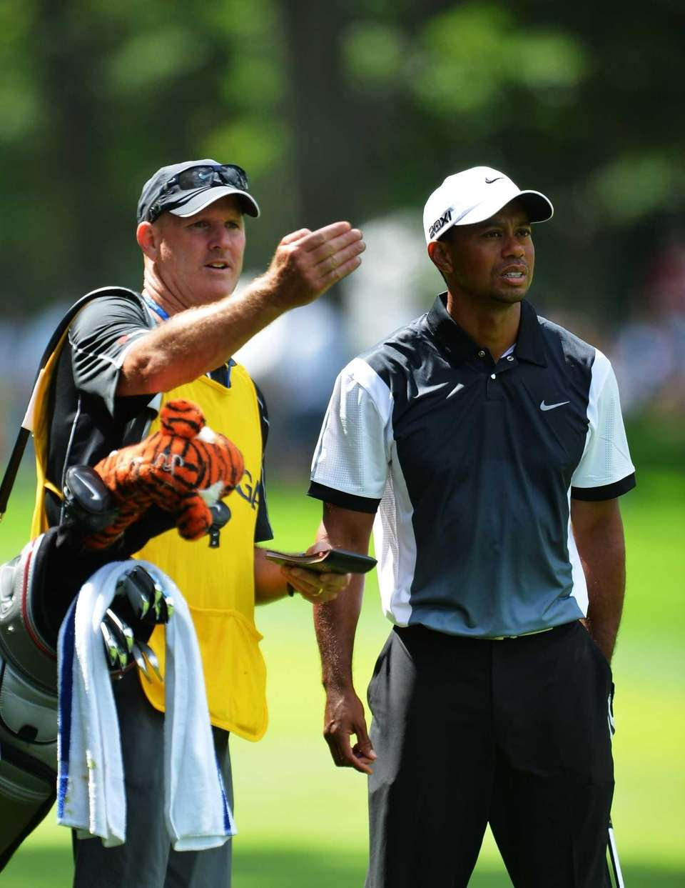 Tiger Woods of the United States chats with