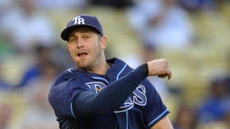 Tampa Bay Rays third baseman Evan Longoria throws