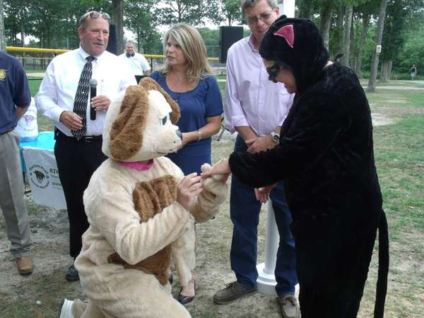 Neil MacDonald, of Riverhead, proposes to Camela Dwyer,