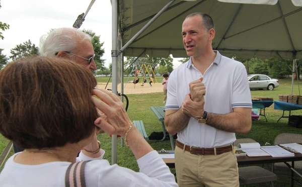 Nassau County Executive candidate Adam Haber talks with