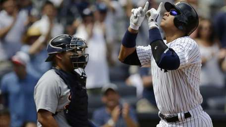 Alex Rodriguez gestures after hitting a solo home