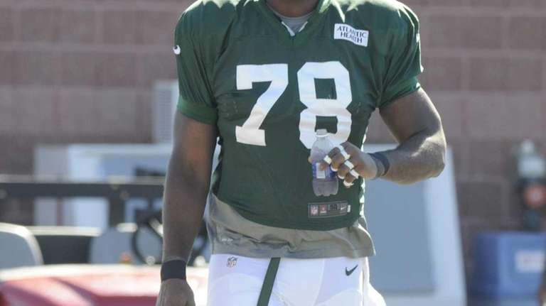 Jets' Leger Douzable walks to the field during