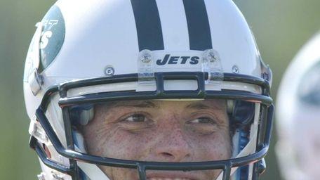 Jets quarterback Greg McElroy looks on during training