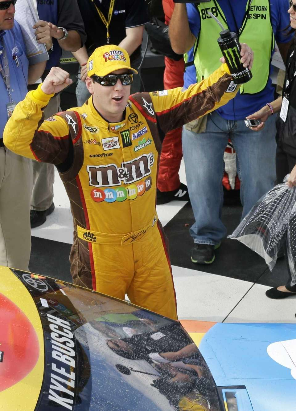Kyle Busch celebrates in Victory Lane after winning