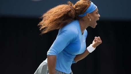Serena Williams celebrates a point during the Rogers