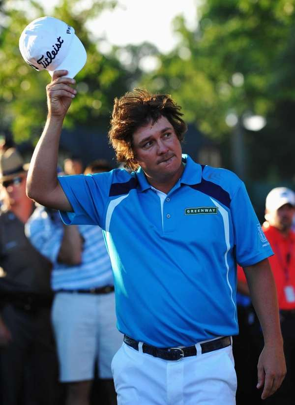 Jason Dufner celebrates on the 18th green after