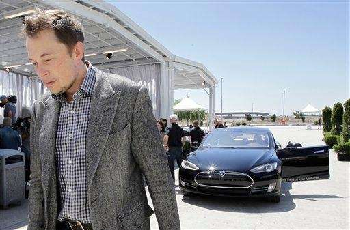 Tesla founder and chief executive Elon Musk walks