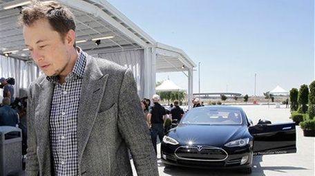 Tesla founder and chief executive Elon Musk walks