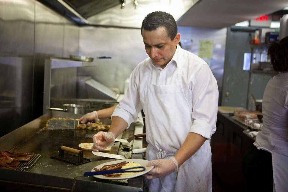 "Owner and chef Edgar ""Javier"" Viera prepares dishes"