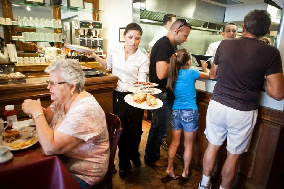 Customers dine at Javier's Café in Smithtown. (August