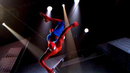 The Spider-Man character is suspended in the air