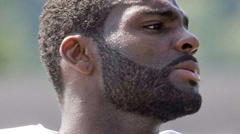 Braylon Edwards (17) looks on during training camp