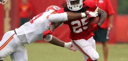 Kansas City Chiefs linebacker Nico Johnson tries to