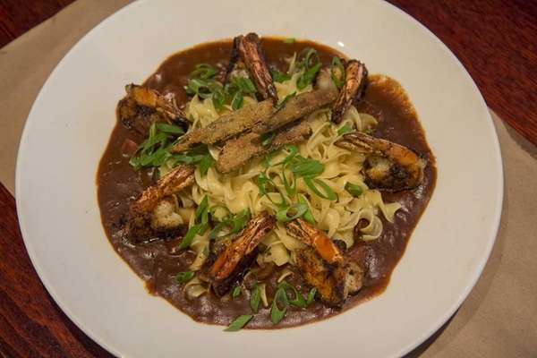 Shrimp gumbo is served over egg noodles at
