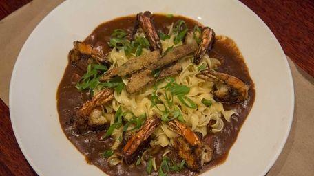 Shrimp gumbo is served over egg noodles at