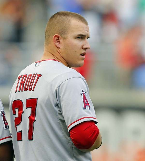 Los Angeles Angels outfielder Mike Trout looks on