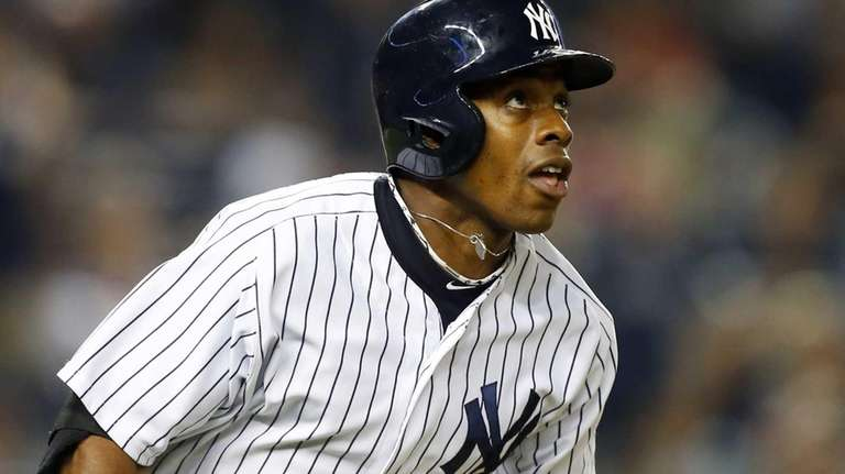 Curtis Granderson watches the flight of his seventh-inning