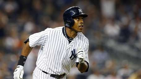 Curtis Granderson watches the flight of his home