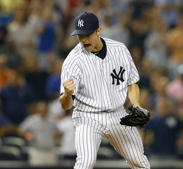 David Robertson reacts after the final out of