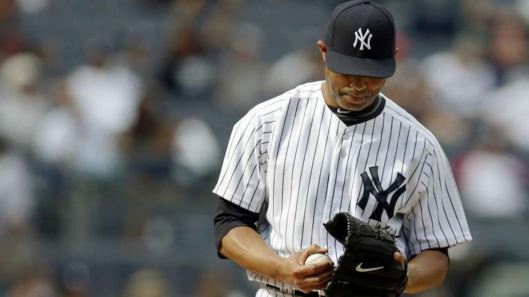 Mariano Rivera reacts on the mound after allowing