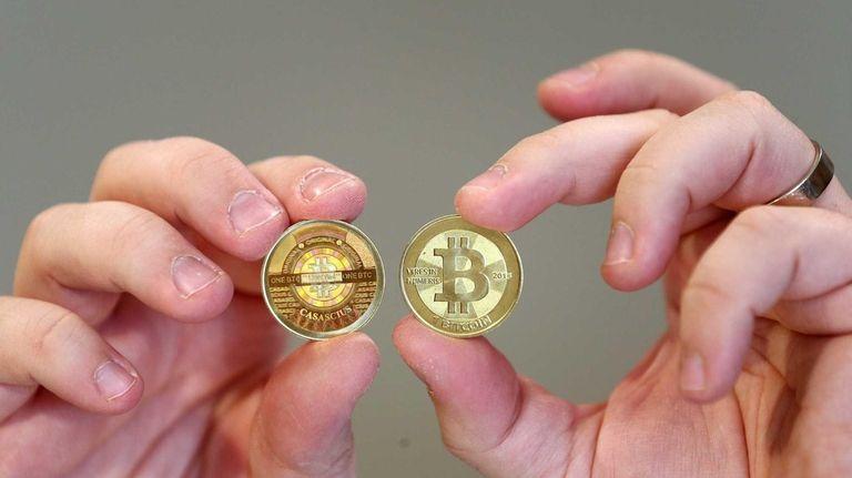 Souvenir coins hold the logo of Bitcoin, a