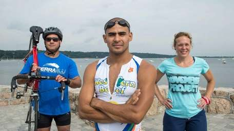 Triathletes Dave Patton, 46, left, Julian Acevedo, 26,