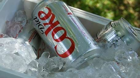 Diet Cokes in an ice chest at a