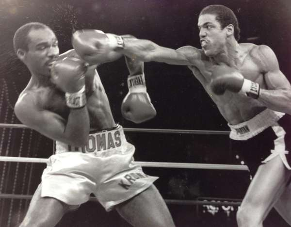 Mark McPherson delivers a punch to Duane Thomas