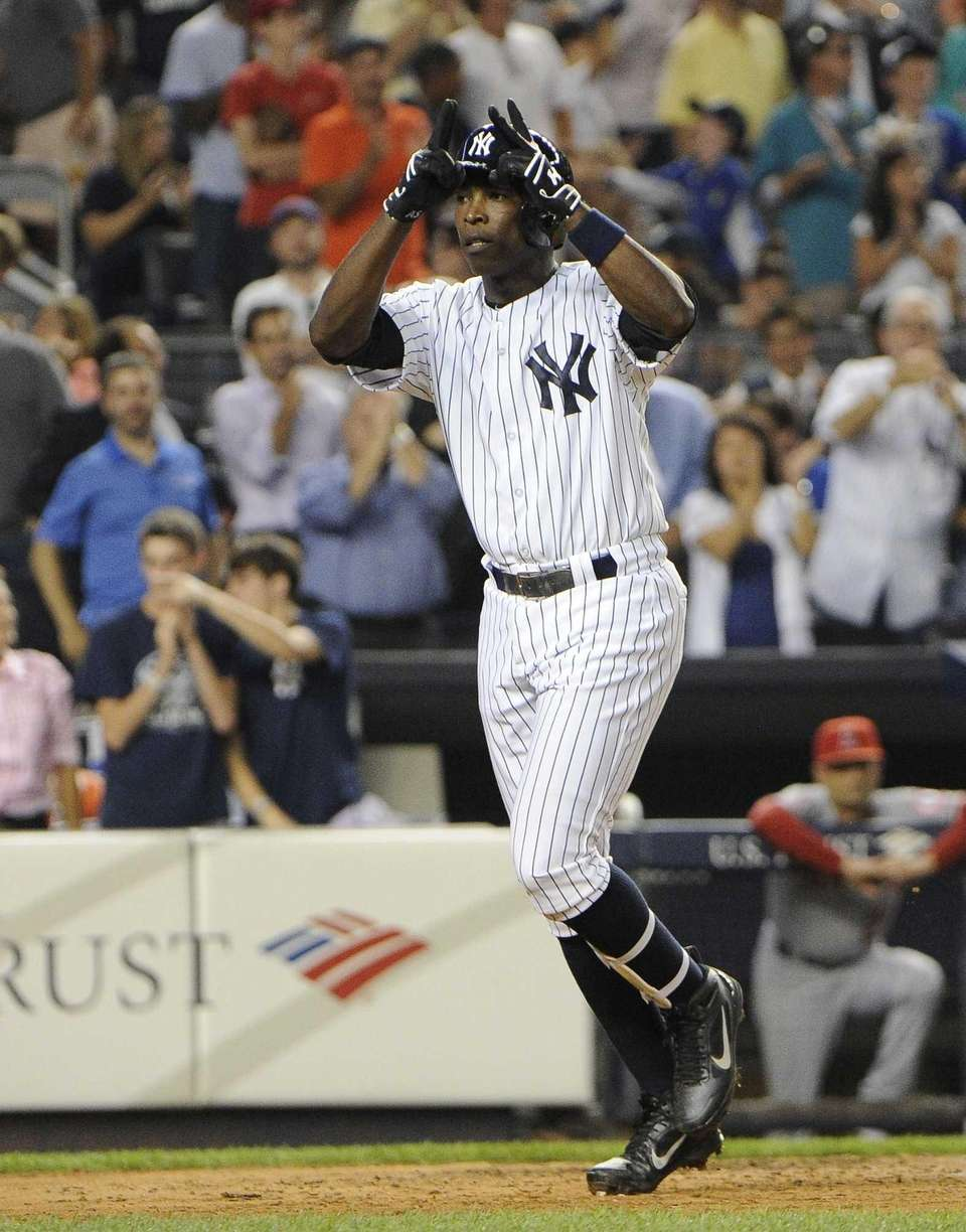 Alfonso Soriano of the Yankees celebrates his two-run
