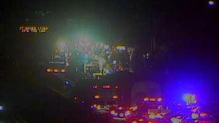 A traffic camera image shows the spot where