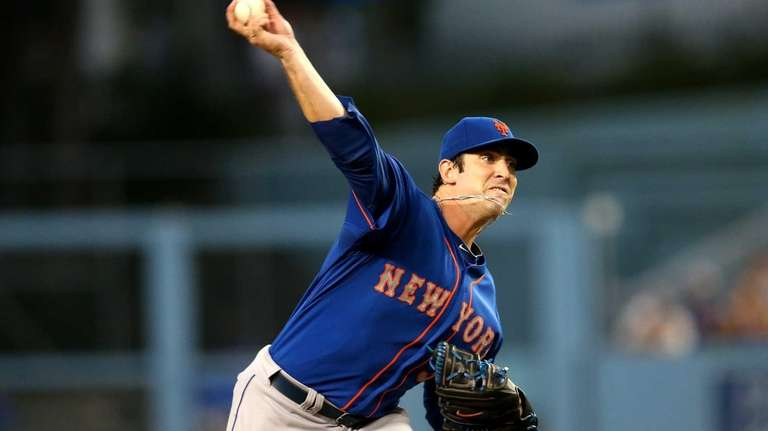 Matt Harvey of the Mets throws a pitch