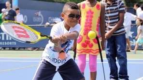 Indijhan Richard of Brooklyn, 6, practices at a