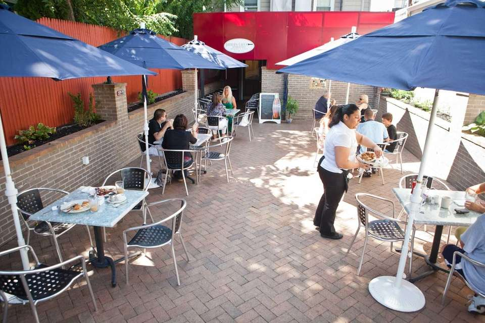 Customers dine in the outside seating area at