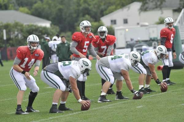 From left, Jets quarterbacks Greg McElroy, Matt Simms,