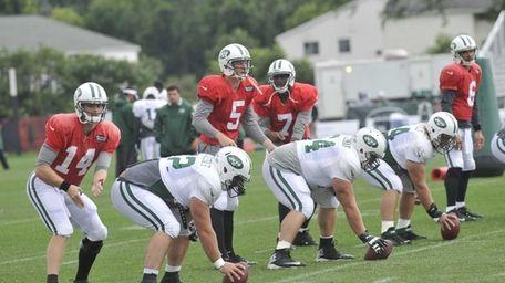 From left, Jets quarterbacks Greg McElroy, Matt Simms,