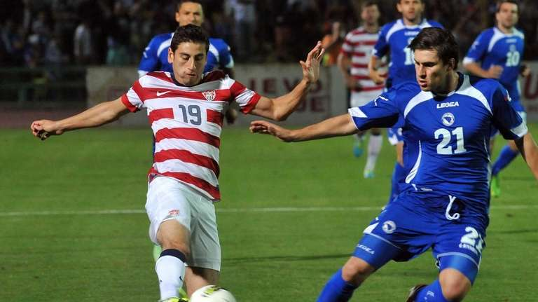USA's Alejandro Bedoya is challenged by Bosnia and