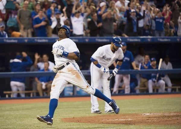 Toronto Blue Jays' Rajai Davis, left, turns for