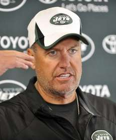 Rex Ryan talks to reporters during training camp