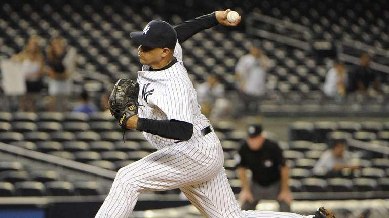 Dellin Betances delivers a pitch in the eighth